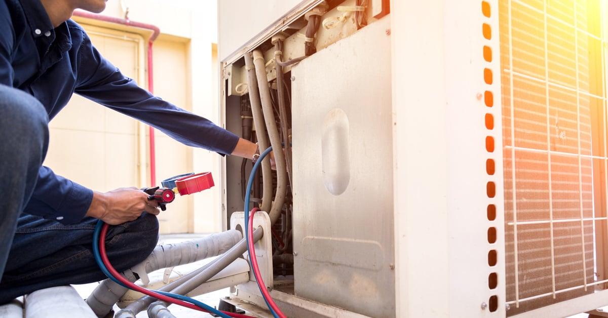 HVAC technician repairing HVAC equipment