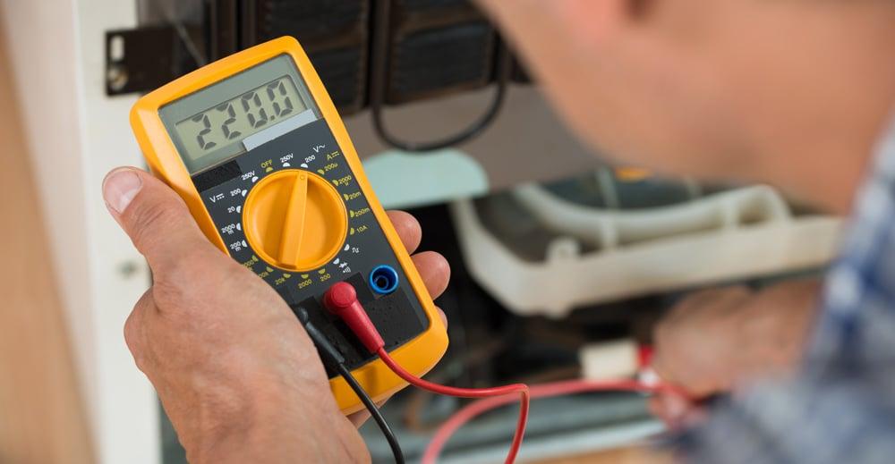 Technician holding multimeter