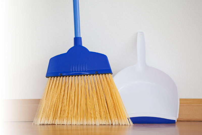 broom sweeping dust