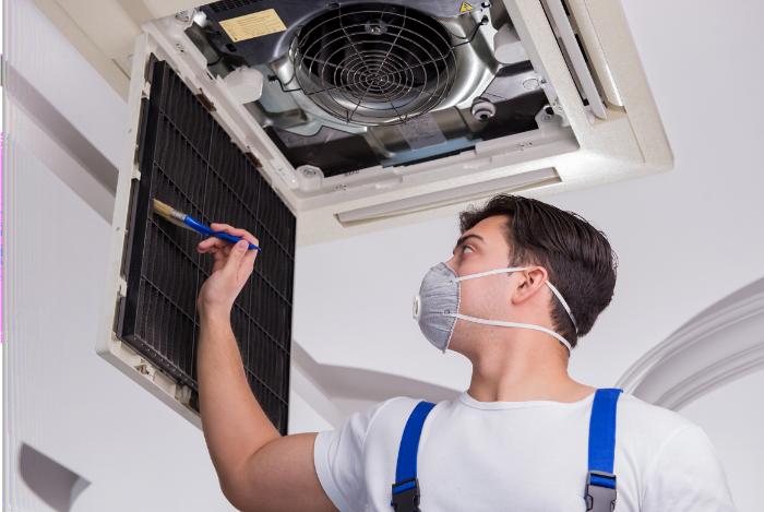 technician working on AC repairs