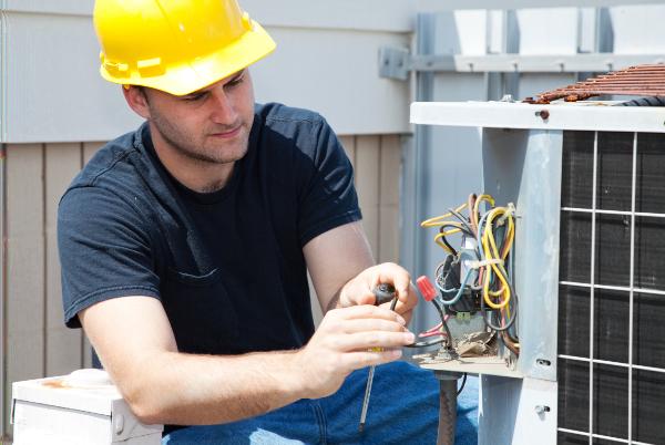 technician doing hvac repairs